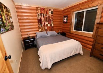 The main floor bedroom has a queen bed