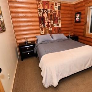 Main floor bedroom has a queen bed